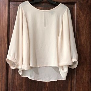 Forever21 cream blouse with wing sleeves.